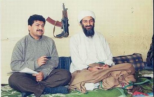 Hamid Mir interviewing Osama bin Laden for Daily Pakistan in 1997 behind them on the wall is an AK-74 carbine.