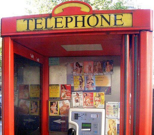 Tart cards in phone box.