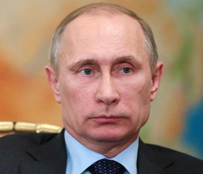 Putin in chair 650